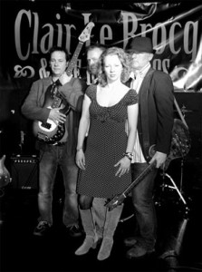 Clair Le Brocq and the Bordellos. Left to right - Steve Fuller - Bass Guitar, Ivor Lane - Drums, Clair Le Brocq - Vocals, Guitar, Saxophone, Iain Mackay - Guitar, Vocals